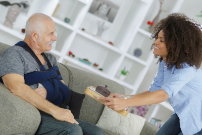Caregiver serving a meal to senior man