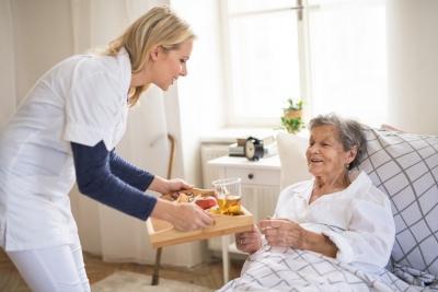 caregiver serving a meal