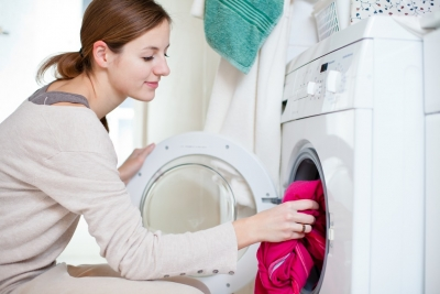 young caregiver doing laundry